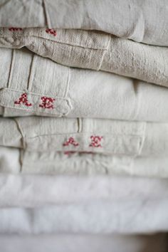 Stack of vintage monogrammed night shirts