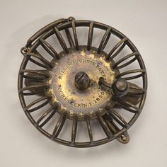 William Billinghurst Reel. Accession No. 1985.29.1.  Diameter 3 inches, depth 3/4 inches, weight 3 1/4 ounces. William Billinghurst (1807-1880) was a well known gunsmith whose patent for a side-mount reel built of wire and castings is now considered to be the first American fly reel.  The unique appearance of these reels has prompted some to refer to them as birdcage reels.
