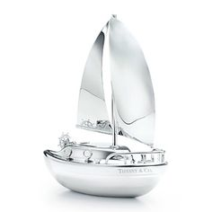 Sailboat bank in sterling silver.