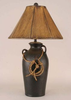 Distressed Black Lasso Lamp Western Lamps - Pottery urn with distressed black finish is accented with rope lasso and rustic shade. Made in the USA.