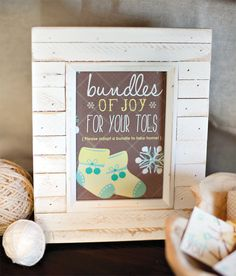 """""""Bundle Up, Baby"""" shower signage. Roll socks up and tie them with yard with a note that says """"Bundle up and get cozy"""". Super cute. #babyshower #party #partyfavors"""
