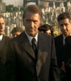 Don Barzini pays his respects at Vito's funeral.