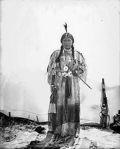 A portrait of a Native American (Ute) woman, identified as Buckskin Charlie's wife, probably in Colorado. The woman stands in front of a tepee and wears a full length, animal hide dress with hemline f Native American Pictures, Native American Tribes, Native American History, American Art, American Quotes, American Symbols, American Women, Native Indian, First Nations