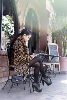 Love the tights with high heels, short dress, and long coat.