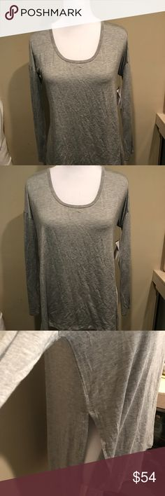 NWT - Beyond Yoga Gray Long Sleeve Top - Size S NWT - Beyond Yoga Gray Long Sleeve Top - Size S Slits on the sides... Yummy and super soft Beyond Yoga Tops Tees - Long Sleeve
