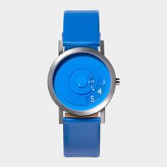Awesome. The Reveal Watch, where time fades in and out. It is an analog watch that reads in a digital manner.