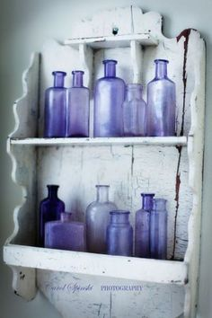 lavender coloured vintage bottles on old shelf, I want this done in my bathroom. any one know where i can get some old bottles? Antique Bottles, Vintage Bottles, Bottles And Jars, Antique Glass, Glass Bottles, Perfume Bottles, Vintage Perfume, Antique Hutch, Painted Bottles