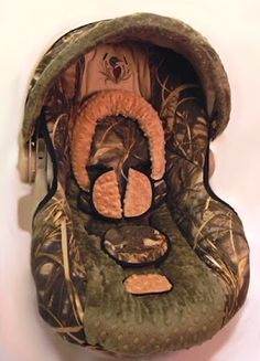 Cause babies need to have a camo carseat. To go hunting. Because, why else would someone need to camouflage themselves as if they were in the forest?