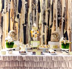 """For classroom: Ripped Fabric curtains-Use colors blueberry, cream, cucumber green-add some """"things"""" to hand on the strips-shells, beads, chandelier crystals, etc. Use as an accent with cafe curtain sheers behind it."""