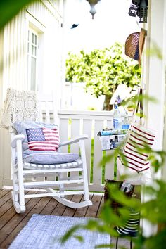 White rocker, straw hat, and some American flags...what more could a country back-porch want or need?