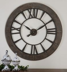 Shop for Uttermost Ronan Wall Clock, and other Accessories at Englishman's Interiors in Dallas, TX. Dark, rustic bronze finish accented with a rust gray frame.