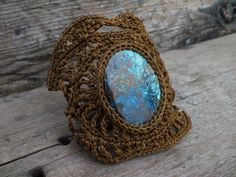 This cuff bracelet was handmade crochet by me with Azurite gemstone and Camel Brown thread. <3 by AmorArt