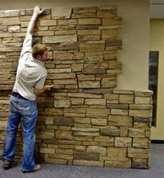 Faux stone. Easy to pop on the side of a house for an exterior ...