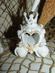 Fairy Tale Cinderella Wedding Set with Knife and Server Cake Set, and Pen and Holder Beach Style with Natural Starfish, and Baby Shells. $28.00, via Etsy.