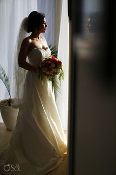 Lovely gown by @Paloma Blanca at a destination wedding at @Al Cielo Hotel XpuHa in the Riviera Maya. Mexico wedding photographers Del Sol Photography.