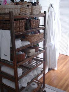 Vintage wooden shoe rack used in the bathroom