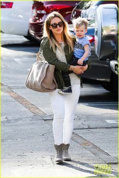 Hilary Duff carries her 23-month-old son Luca while heading back to her car after indulging in some retail therapy on Thursday (February 20) in Beverly Hills, Calif