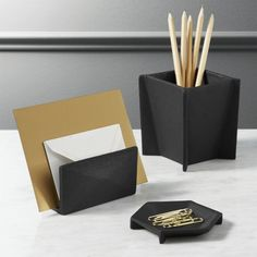 Shop black cast desk accessories.   Textured matte black aluminum containers are designed to resemble true cast iron.  Sophisticated yet modern shapes are an upgrade for any office.