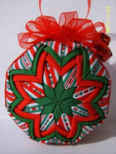 Christmas Stripes Quilted Ornament by JCCrafts on Etsy, $18.00 also see the pininterest board at http://www.pinterest.com/kasiaw117/temari/