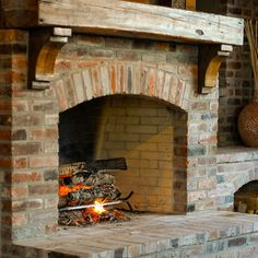 Custom hand-carved reclaimed wooden mantle above this true masonry old brick fireplace brings warmth to this custom outdoor kitchen in more ways than one! Brick Fireplace, Rustic Fireplaces, Home, New Homes, Outdoor Fireplace, Brick, Rustic Mantle, Fireplace, Outdoor Kitchen