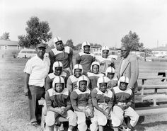 Earl Goins (in white shirt), pictured in 1957, coached football and helped advocate for improvements at Rochester Park. Located in the Great Trinity Forest, Rochester Park, Dallas, Texas, began when residents created their own baseball diamonds. In 1941, the Rochester Park Civic League appealed to the city for upgrades to the facility, such as playground equipment. Photo courtesy of R. C. Hickman Photographic Archive