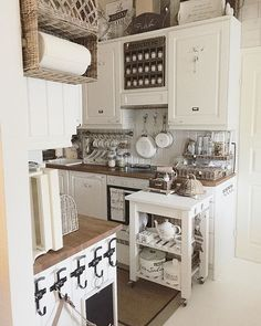Paper towels in a basket-holder, spice jar organized above the stove