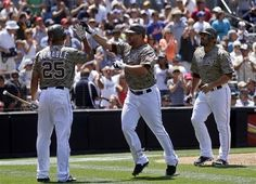 Game #111 8/5/12: San Diego Padres' Yonder Alonso, center, is congratulated by teammate Will Venable after hitting a two-run home run against the New York Mets during the third inning of a baseball game on Sunday, Aug. 5, 2012, in San Diego. Padres' Carlos Quentin, right, also scored on Alonso's hit. (AP Photo/Lenny Ignelzi)