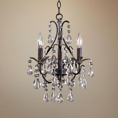 I really like this for our bedroomCastlewood Walnut Silver Finish 3-Light Mini Chandelier | LampsPlus.com