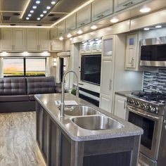 Make more than just camp snacks in this Luxe Gold Kitchen! Camp Snacks, Luxury Fifth Wheel, Instant Water Heater, Full Body Paint, Gold Kitchen, Roller Shades, Theater Seating, Room Paint, Entry Doors