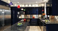 Black kitchen cabinets and metallic backsplash