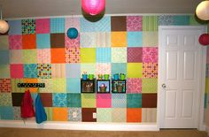 Scrapbook Paper Wall Cover - great way to hide those ugly block walls.