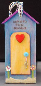 Balsa wood handcrafted tag this is an interesting use of mixed media to create this 3D effect Beach hut.  I love the use of real sand under the door