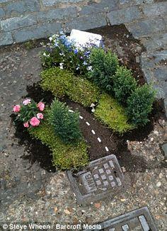 Road bends ahead: The guerilla gardener creates a roadside scene by a drain