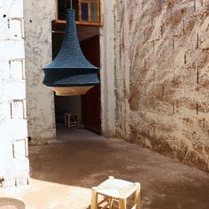 On the road to the Atlas Mountains at the far reach of Marrakesh city rests a little village where a community of women handcraft our crochet pendant Pendant Light Fitting, Moroccan Design, Marrakesh, White Lead, Light Fittings, Hand Spinning, A Table, Pendant Lighting, Atlas Mountains