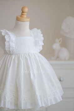 Best 12 Needing a classic white dress for a little girls communion or baptism or wedding? Introducing our girls handmade Grace Dress for any special occasion in which you need a white dress. We offer this dress with three variations of the cross – blue, p Frocks For Girls, Little Dresses, Little Girl Dresses, Girls Dresses, Vintage Baby Dresses, Baby Dress Design, Baby Girl Dress Patterns, Frock Design, Baptism Dress