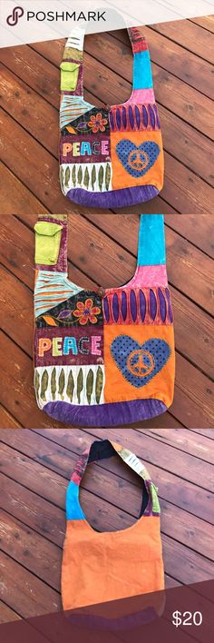 Boho Chic Cross Body Bag Cool Boho Chic Cross Body Bag! Very gently used few times. Inside lined in black with 1 zipper compartment. Zipper top closure with also a brown button closure. On 1 side of handle of Bag is a Velcro pocket great for a cell phone. Says the words peace of front of Bag in different colors along with a peace sign & flower. Beautiful distressed colors. Back of Bag mostly orange. 100% cotton. Hand wash. Made in Nepal. NO TRADES. EUC. Bags Crossbody Bags