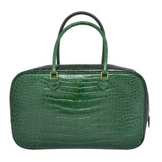 Hermes Paris Vert Fonce Dark Green Crocodile 28 cm Plume Handbag | From a collection of rare vintage handbags and purses at http://www.1stdibs.com/fashion/accessories/handbags-purses/