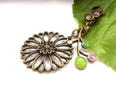 Flower and coloured resin bag charm