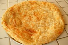 "Egyptian Feteer meshaltet (فطير مشلتت, ""cushion-like pie"") - sometimes savory, sometimes served with cream and honey."