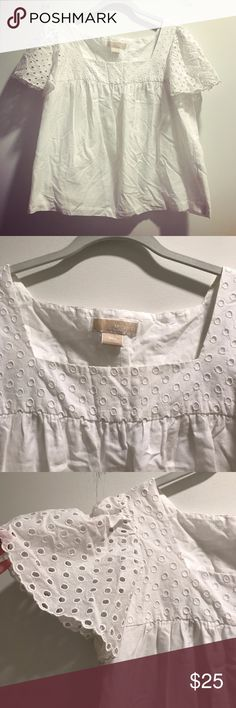 ✨HOST PICK✨ White eyelet Michael Kors top White summery short sleeve top from Michael Kors. The top is 100% cotton, and has flowy eyelet sleeves and a square eyelet neckline. The shirt is fully lined. The style of the shirt is a kind of swing style, so the shirt is very flowy and breezy. In excellent condition! Michael Kors Tops Tees - Short Sleeve
