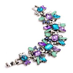 "Crystal Flower Bracelet Gorgeous Crystal Flower Bracelet  Length: 6.89""  Materials: Silver-tone Base Metals, Rhinestones, Resin  Nickel Free, Lead Free  Condition: New Jewelry Bracelets"