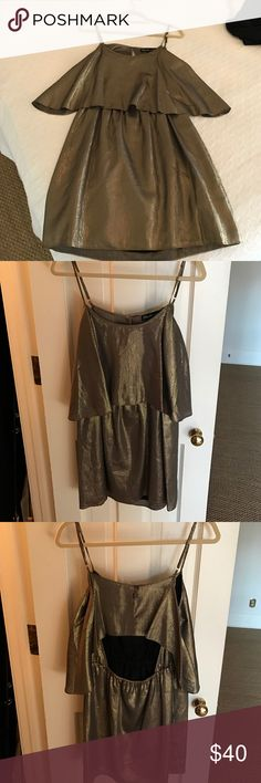 Elizabeth and James gold dress sz S Gold dress with adjustable straps, back is open. Very comfortable and perfect party dress Elizabeth and James Dresses Mini