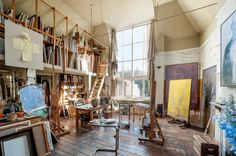 artist's studio-loft storage for paintings. this is pretty awesome.