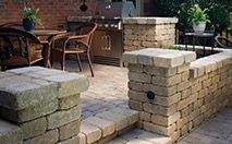 Weston Stone Garden Wall- Weston Stone is a unique block used in creating freestanding walls or stone fences under 2.0 ft in height. This stone can also be used to construct pillars, benches and fireplaces simply by changing the orientation of the stone.