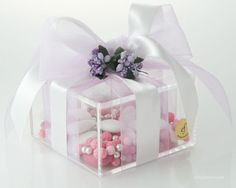 Box made of high quality Plexiglas, decorative hand made flower composition, organza and silk ribbon, Almond confetti candies.