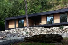 Hungarian architects Attila Béres and Jusztina Balázs recently completed the Hideg House, a holiday home clad in larch wood framing views in a former stone quarry. Residential Architecture, Contemporary Architecture, Architecture Details, Cabin Design, House Design, Green Design, Architects Journal, Timber Cabin, Stone Quarry