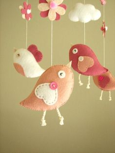Baby Mobile Inspiration, Felt Bird Mobile by Feltnjoy on Etsy  (you can hang mobiles over the food station as a centerpiece and then gift to mommy to be!!  WWW.INFANTEENIEBEENIE.COM~  the only hat guaranteed to fit and stay snug to all newborns.