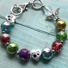 Rainbow Bridge glass bead bracelet with silver leafing. They always leave paw prints on our heart. This bracelet will remind you of that best freind that is always in your heart