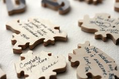 instead of a guest book, make a puzzle out of a photo of the couple and have the guests sign the back of each puzzle piece! i want to do this!!