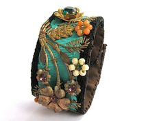 Flowers from vintage brooches and beads over grosgrain ribbon. Designer of Bohemian Chic cuff -- Julia by LalleyGigStudio